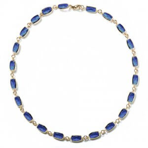 Long blue topaz and yellow gold necklace by A & Furst Jewelry at Kirk Freeport in Grand Cayman